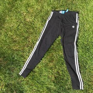 Black with white stripe adidas pants